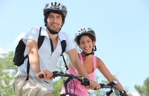Couple-on-bicycle-helmet
