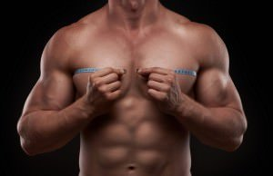 bodybuilder-with-a-measuring-chests