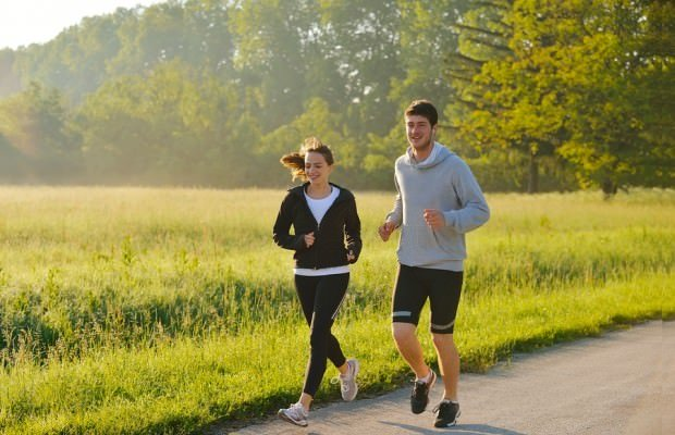 Young-couple-jogging-in-park