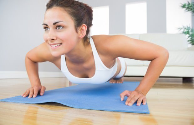 Young-fit-woman-doing-press-up