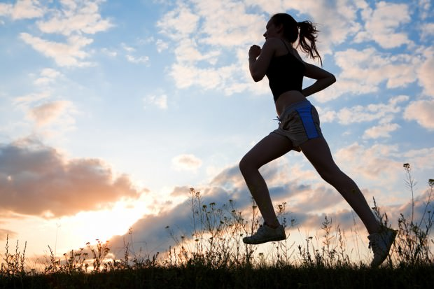 bigstock-Silhouette-woman-run-under-blu-26124965