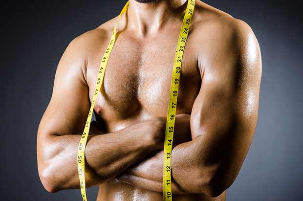bigstock-Muscular-man-measuring-his-mus-45265195