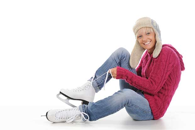 bigstock-Beautiful-Girl-Puts-On-Skates-9825401