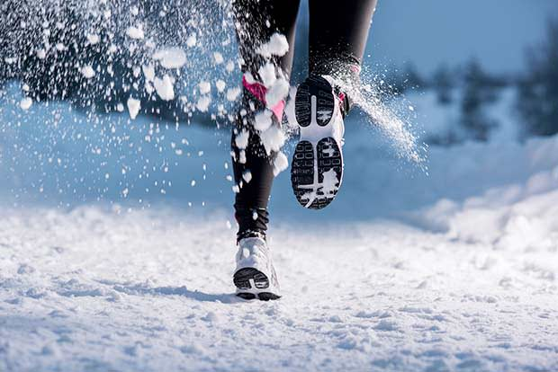 bigstock-Woman-running-in-winter-48719876